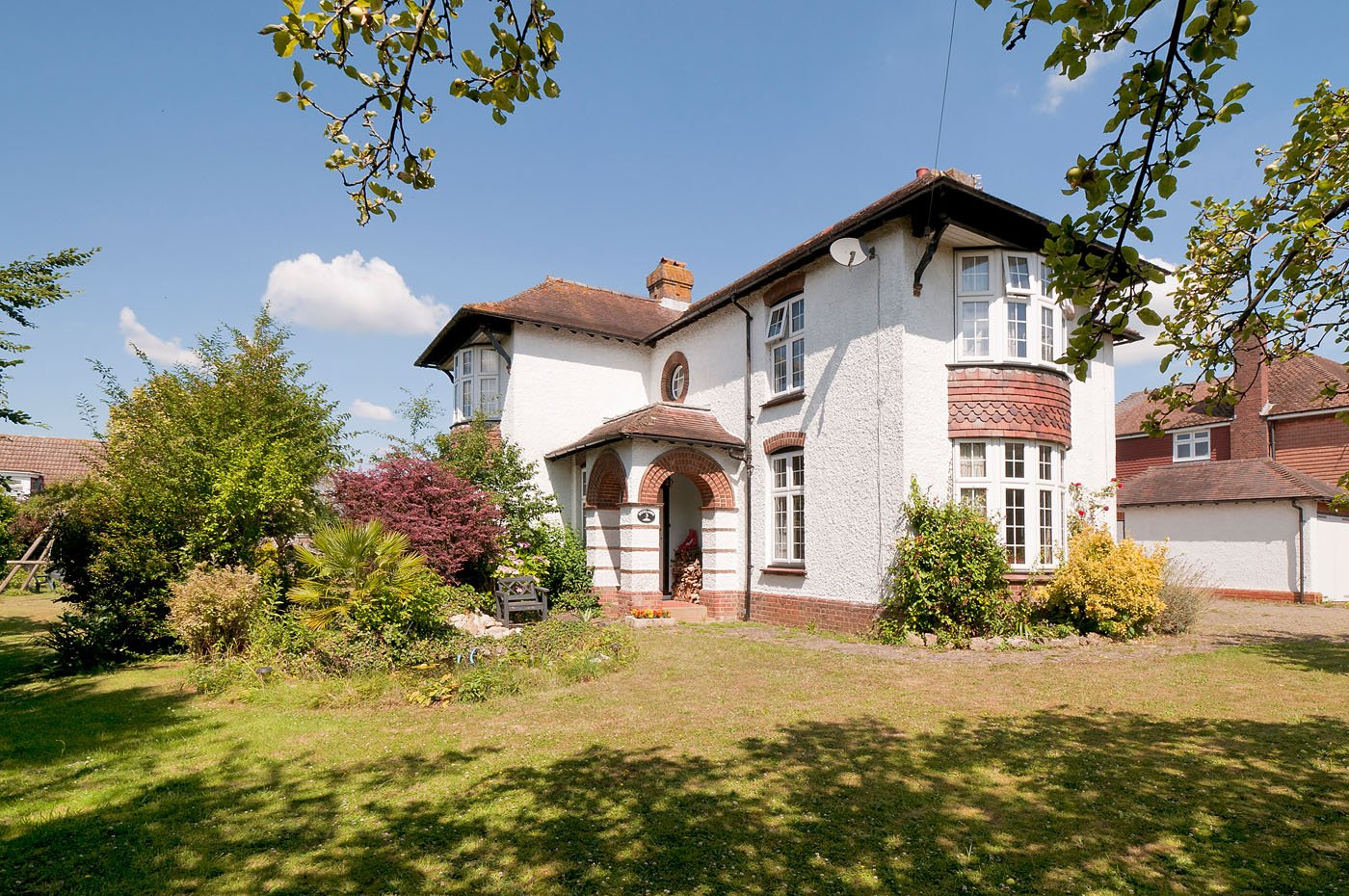 1930s white detached period home in countryside with bay windows