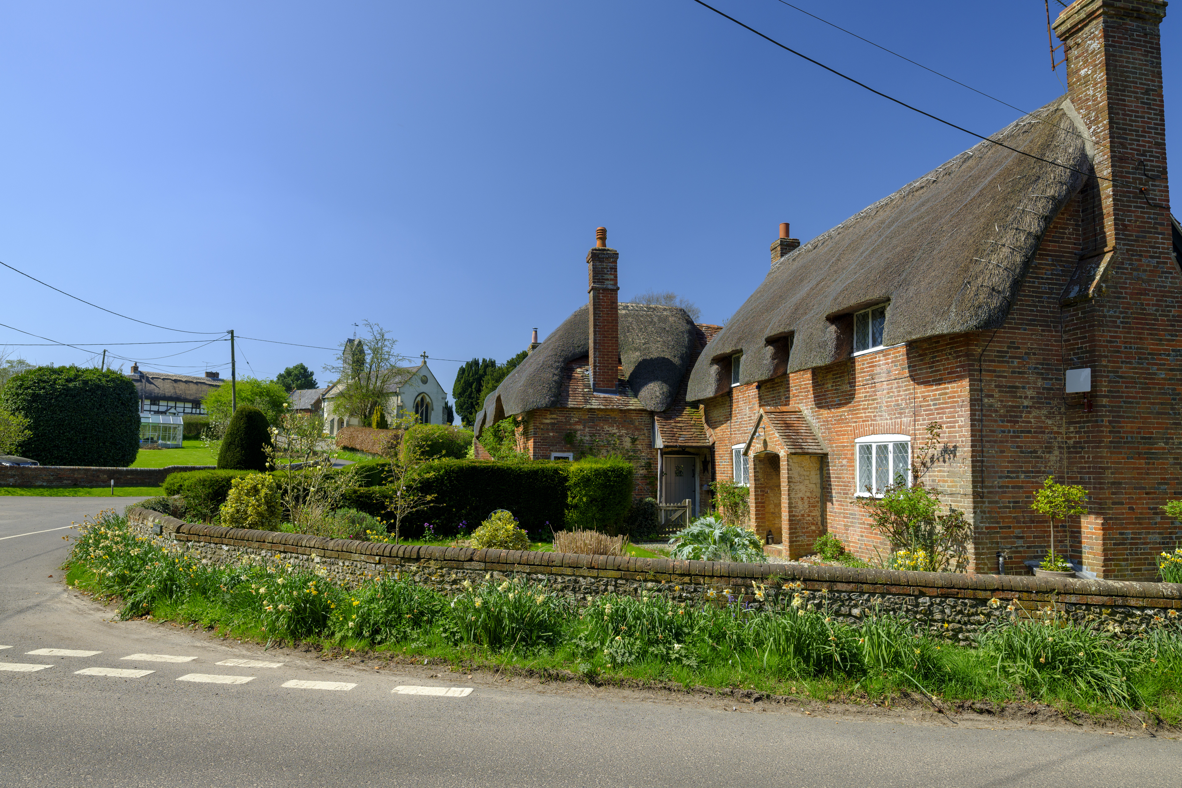 Afternoon spring sunshine in Beauworth Village, Hampshire, UK