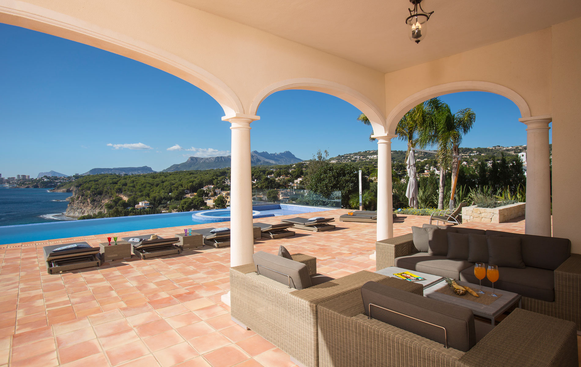 Spain sun terrace area with swimming pool and sea views