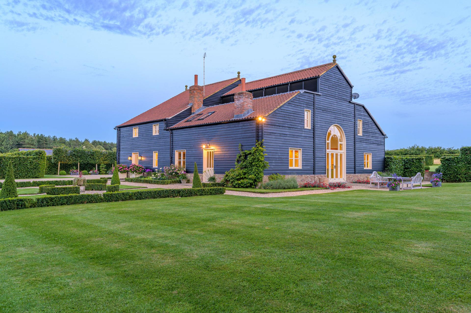 amazing Dutch Gabled barn house in countryside at dusk