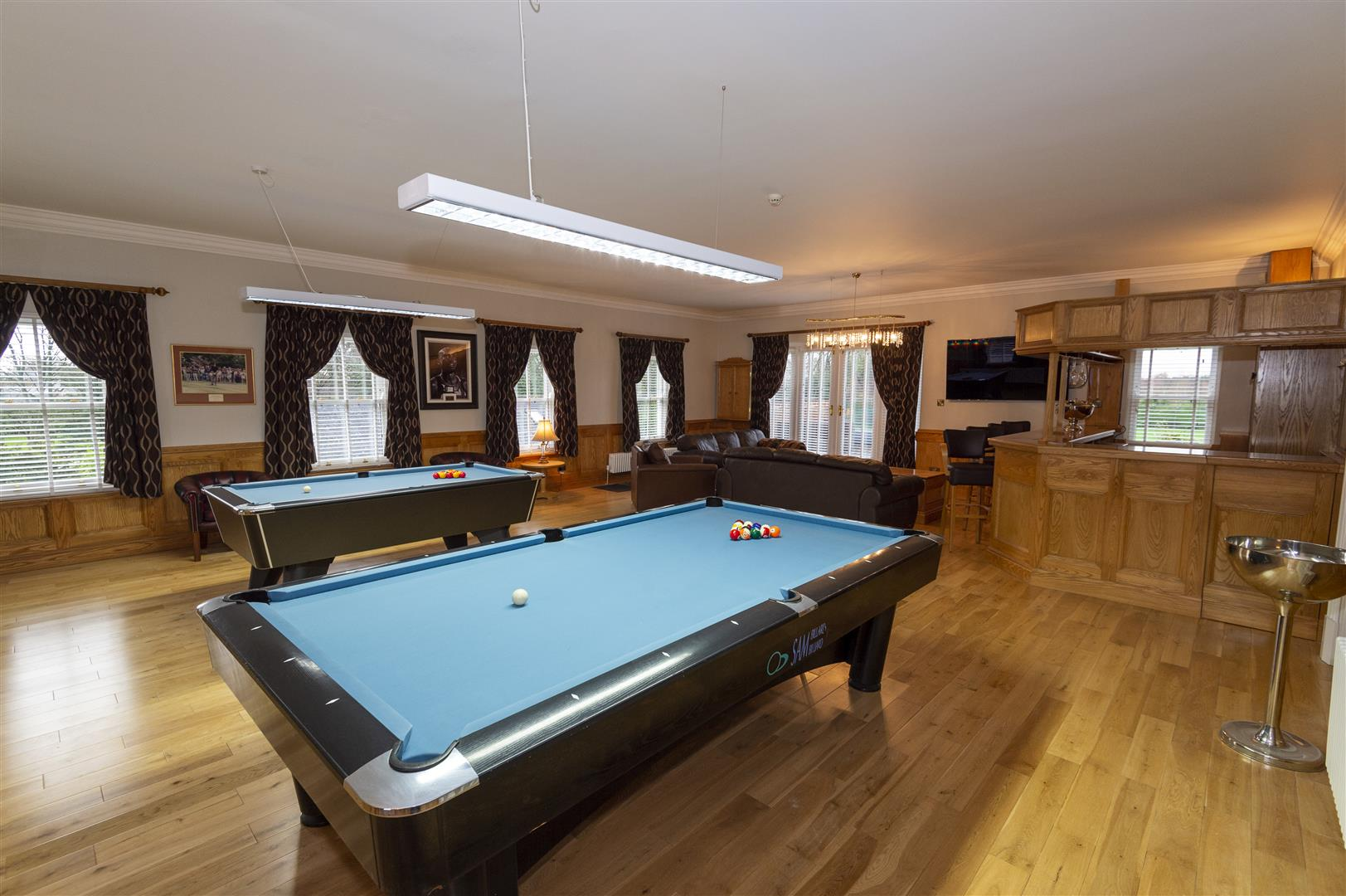 amazing wooden fitted bar with two pool tables