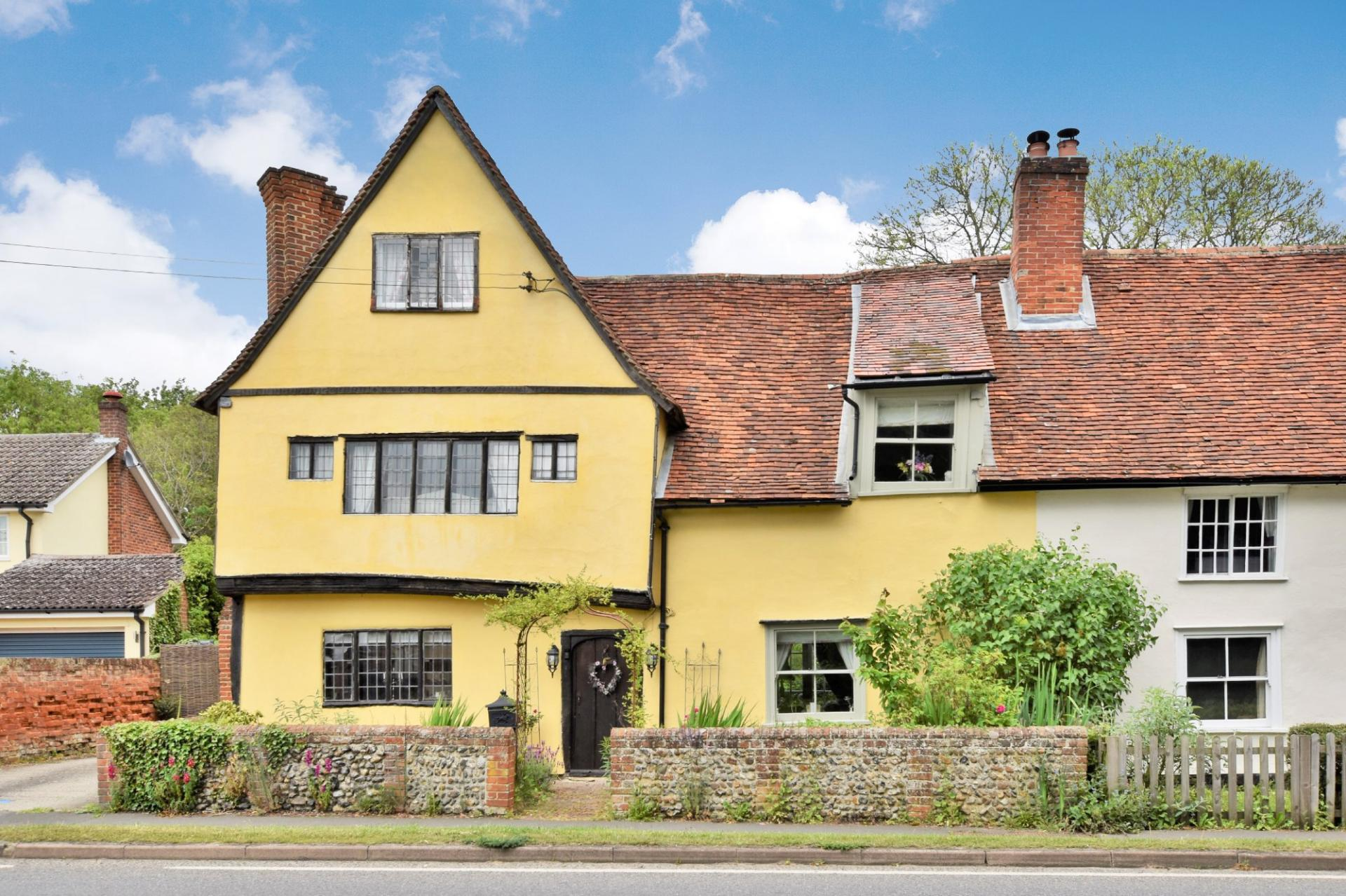 attractive traditional yellow Grade II listed hall house 1400s
