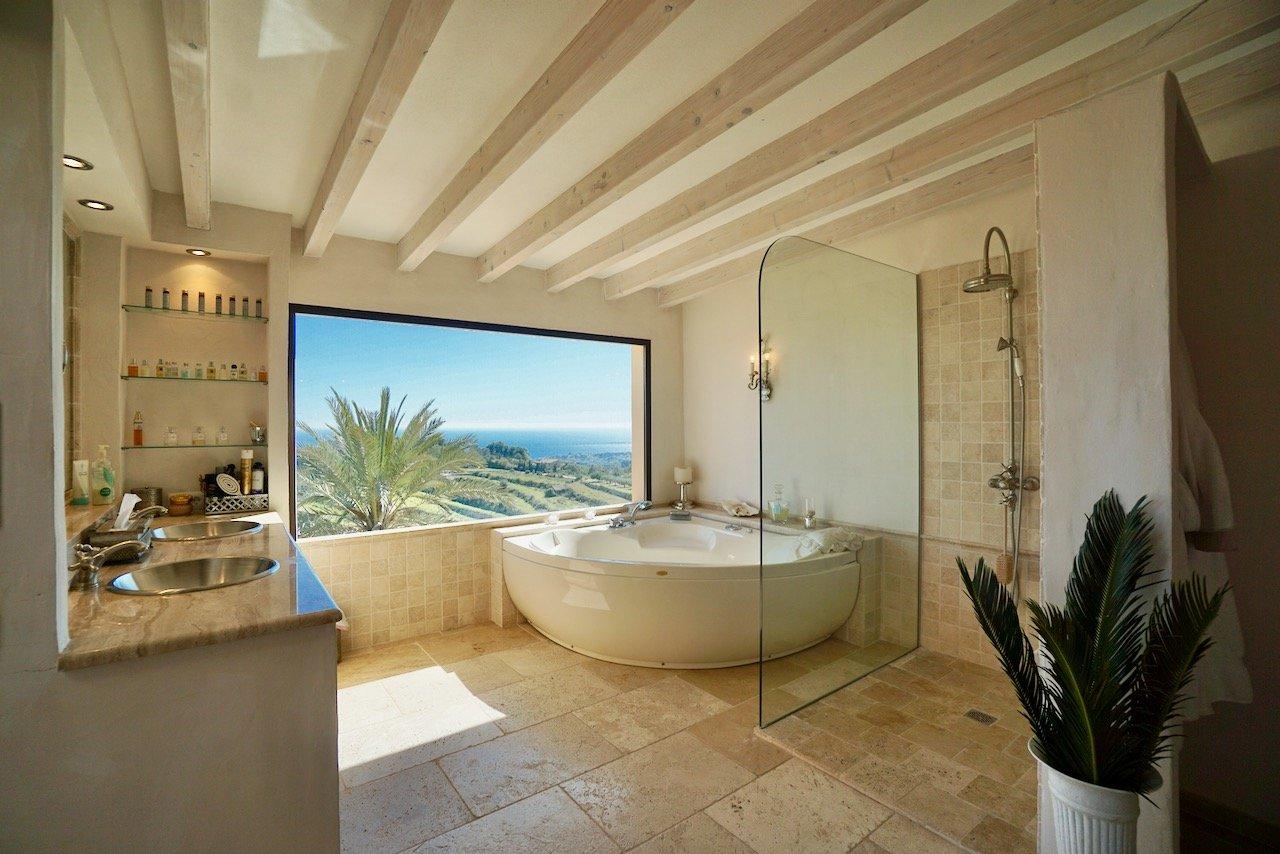 contemporary limestone tile bathroom with round corner bathtub