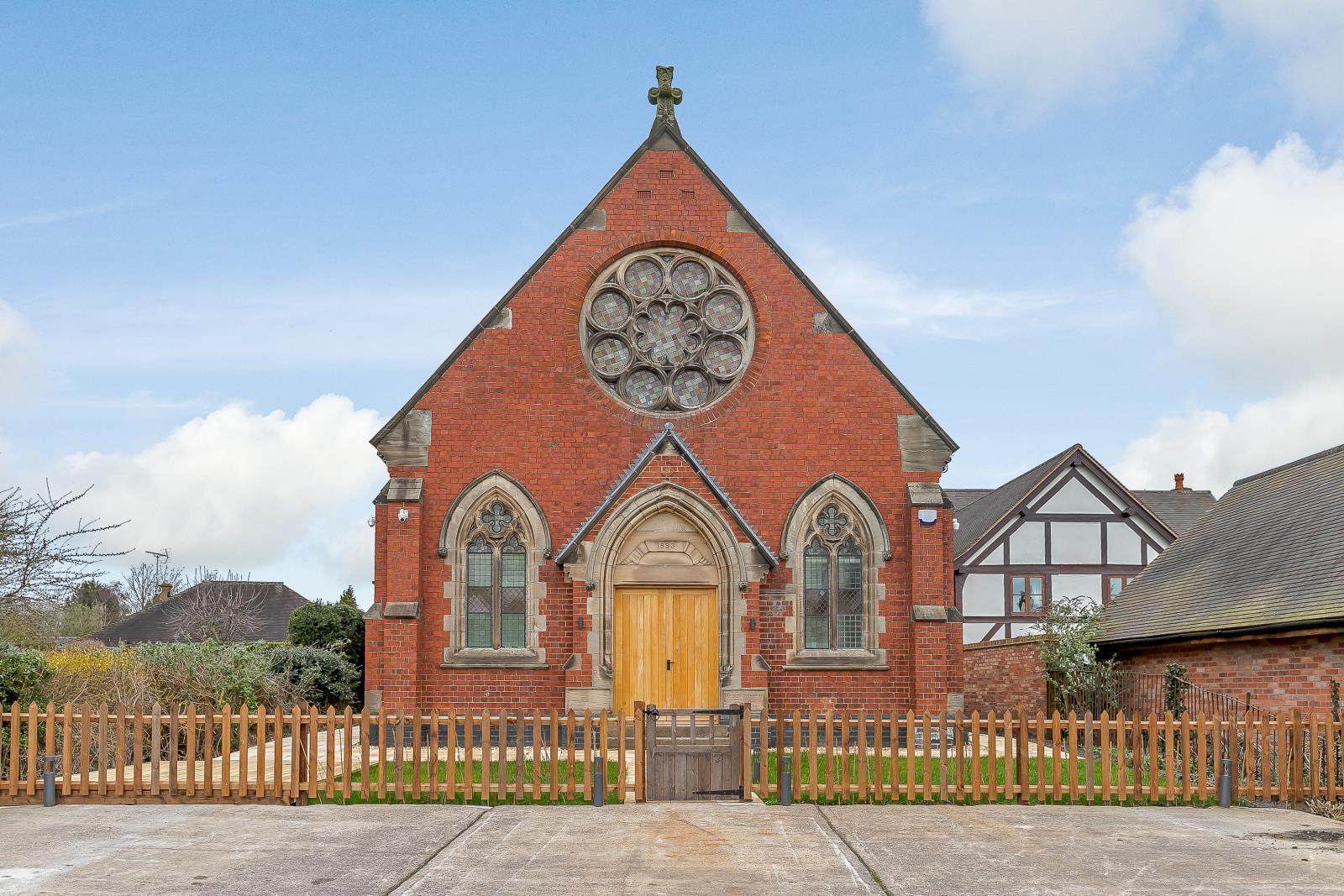 beautiful chapel church house conversion with ornate windows