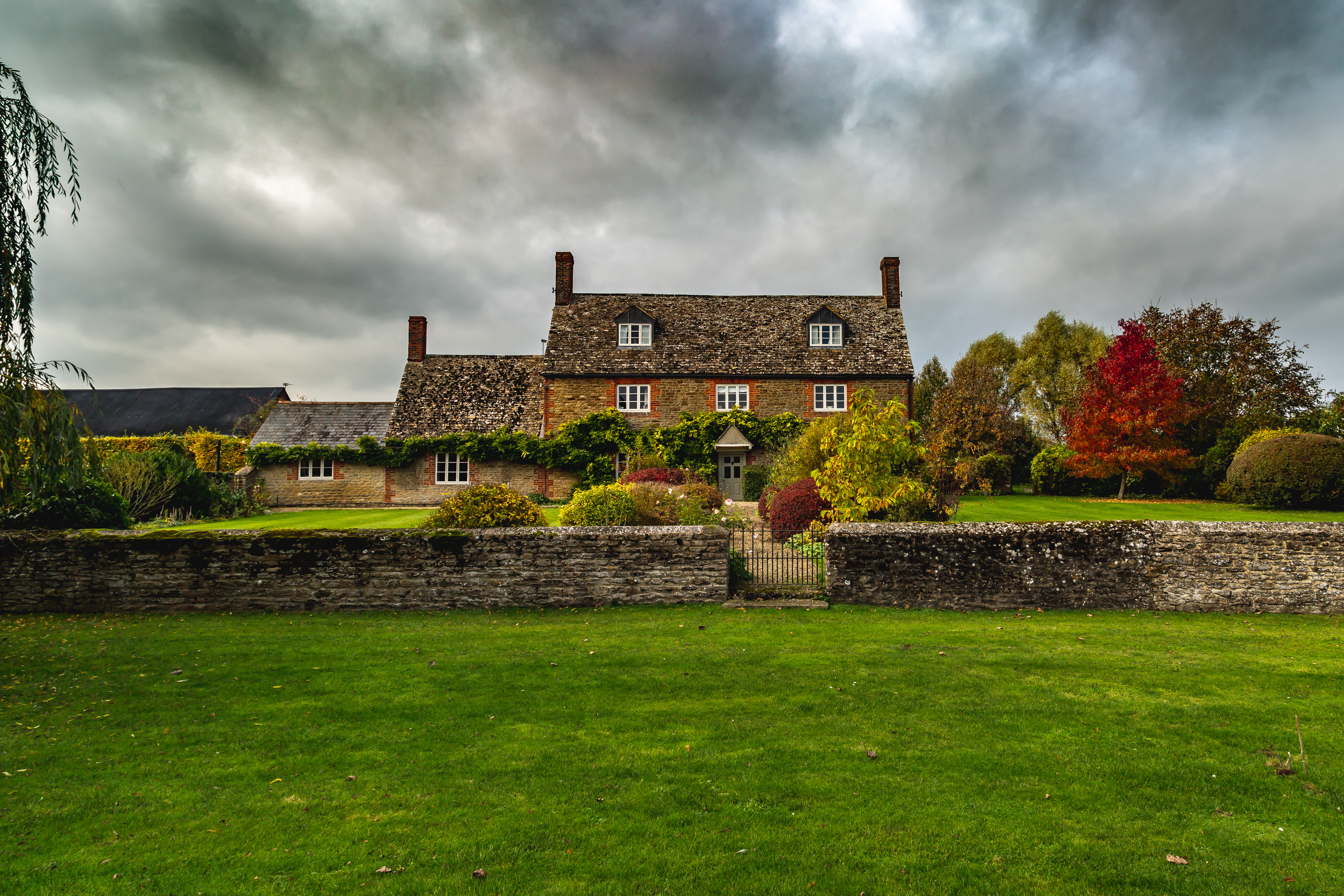 beautiful countryside period home cloudy day