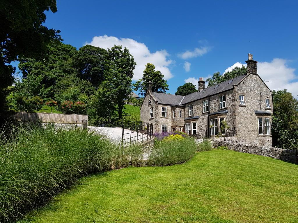 beautiful stone built traditional country home with english garden