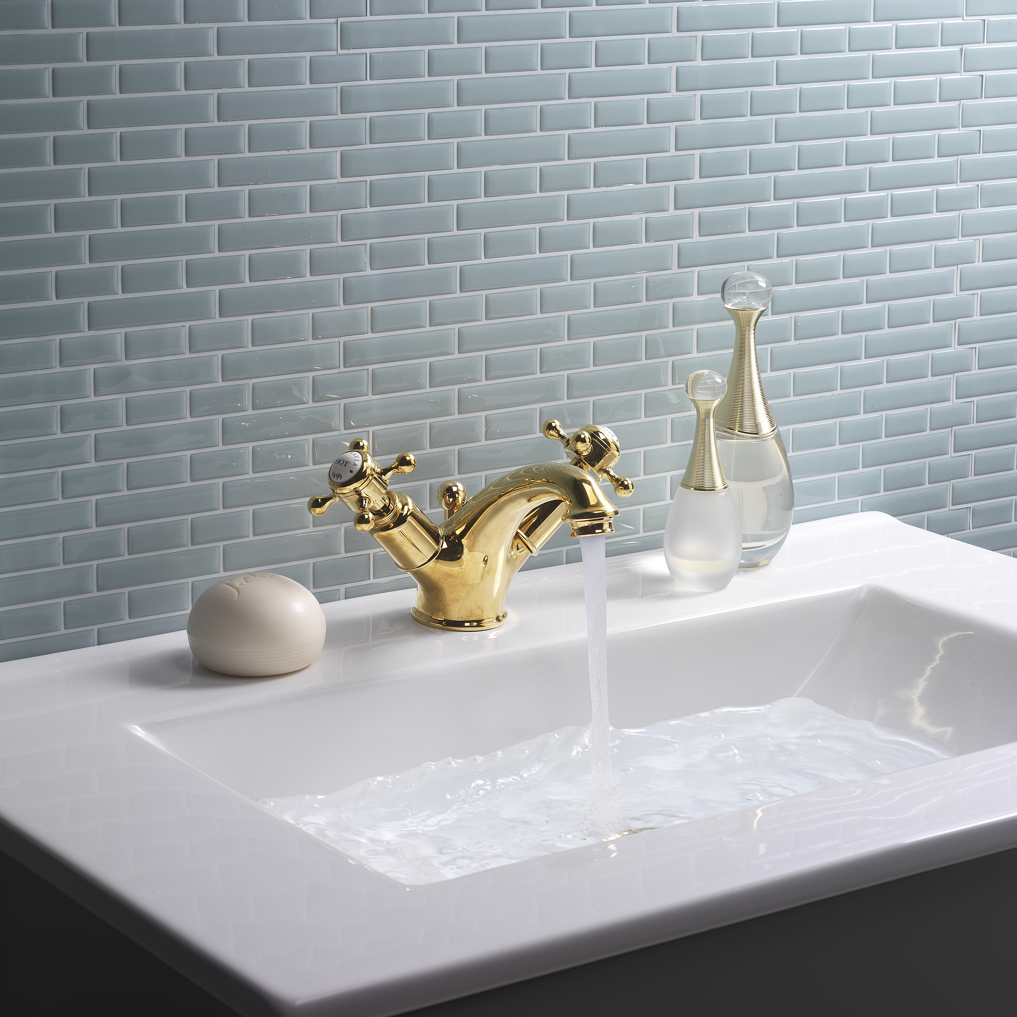 Crosswater blue tiled bathroom with brass taps interior design