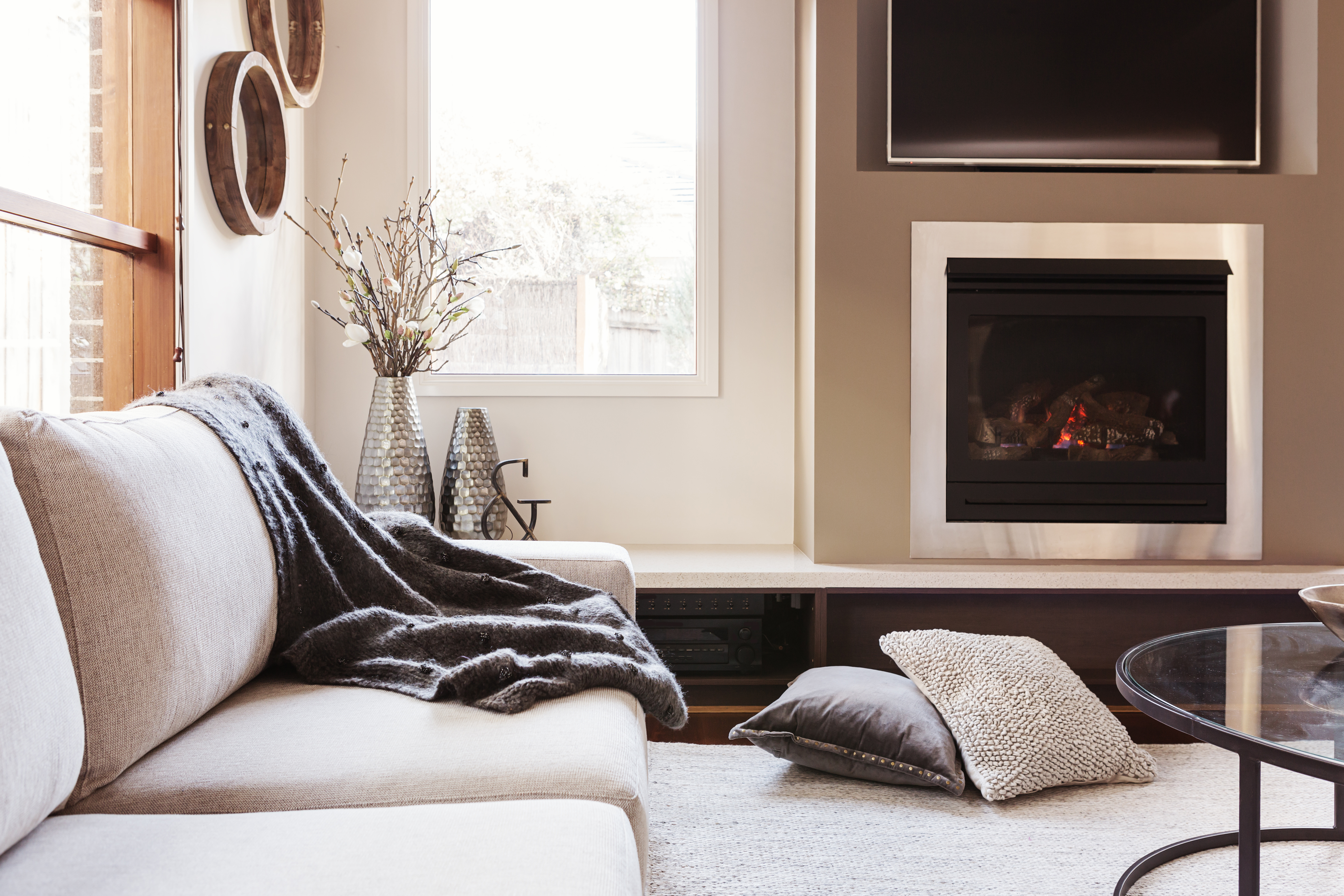bright living room cosy sofa fireplace interior design