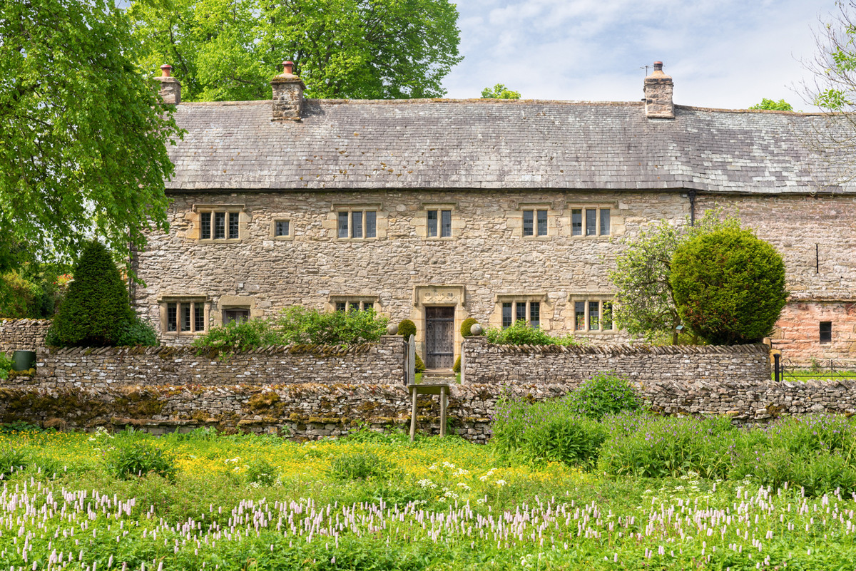 character stone build Elizabethan period hall house in meadow