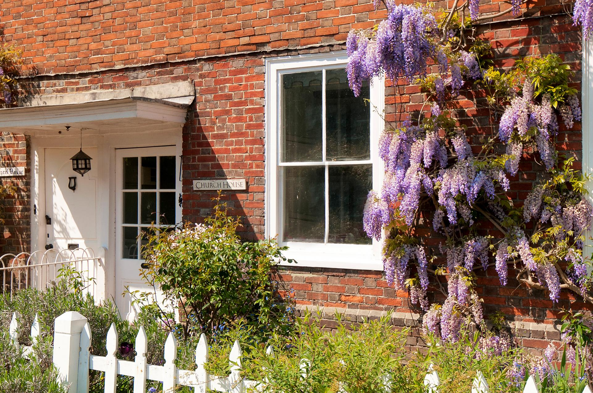 church house cottage with pretty wisteria and garden