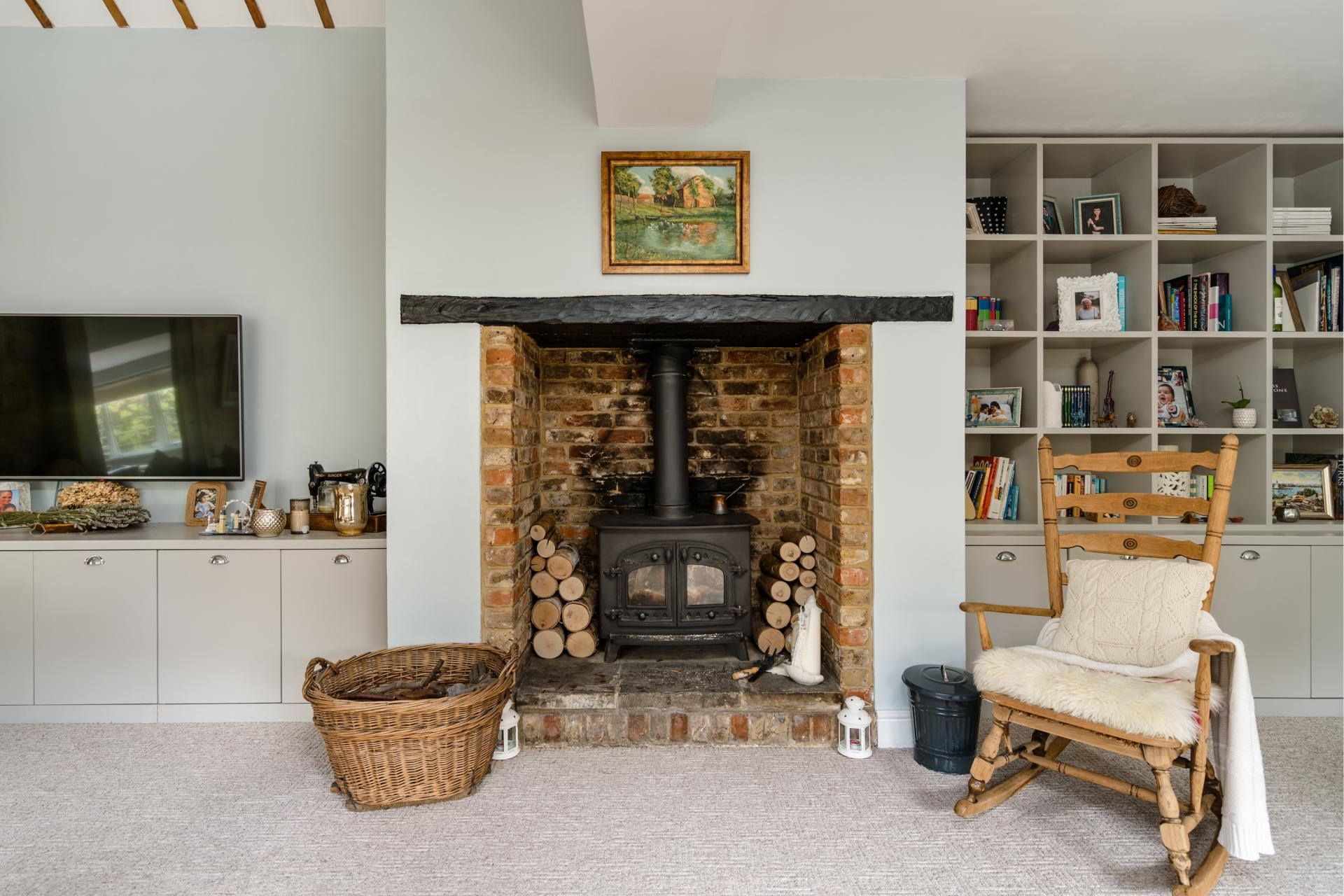 contemporary living room with brick lined open fireplace and traditional wood burning stove