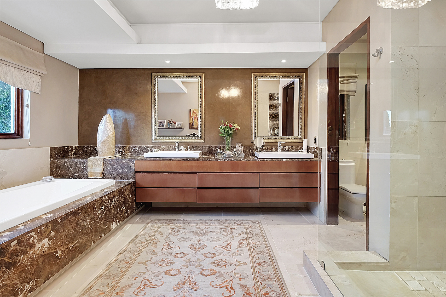 earthy natural marble luxury bathroom with Persian rug