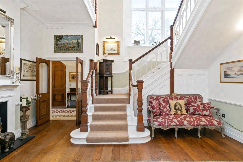 grand entrance hall with wooden staircase in Victorian period home