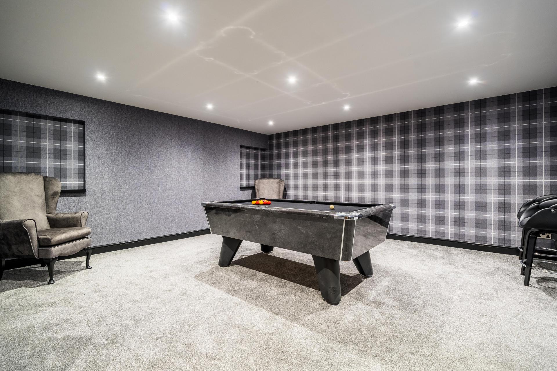 home bar and games room with grey pool table and tartan wallpaper