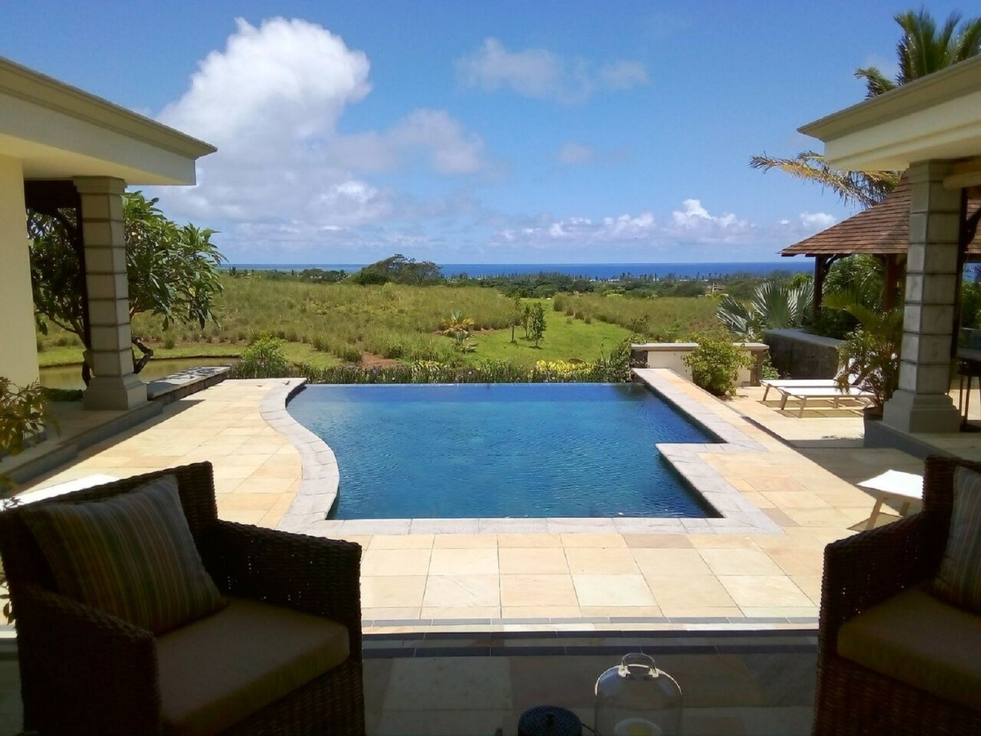 infinity swimming pool in luxury villa overlooking coastal sea views