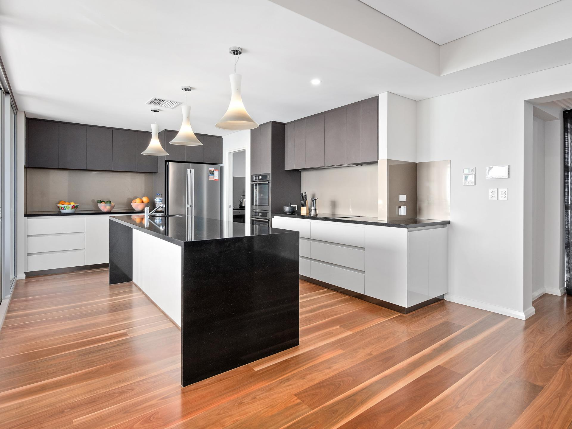 Boasting an exquisitely planned interior of monochromatic minimalism this kitchen is the heart of the home