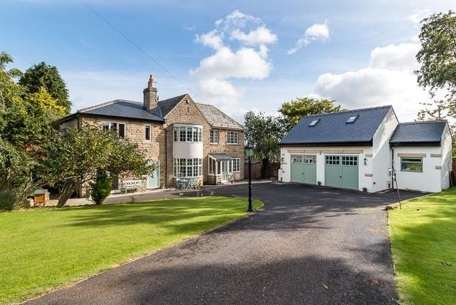 large english stone built dream family home with blue doors