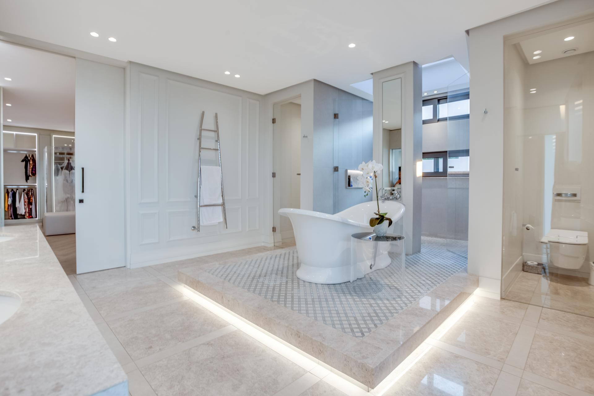 contemporary bright luxury bathroom with freestanding slip bathtub