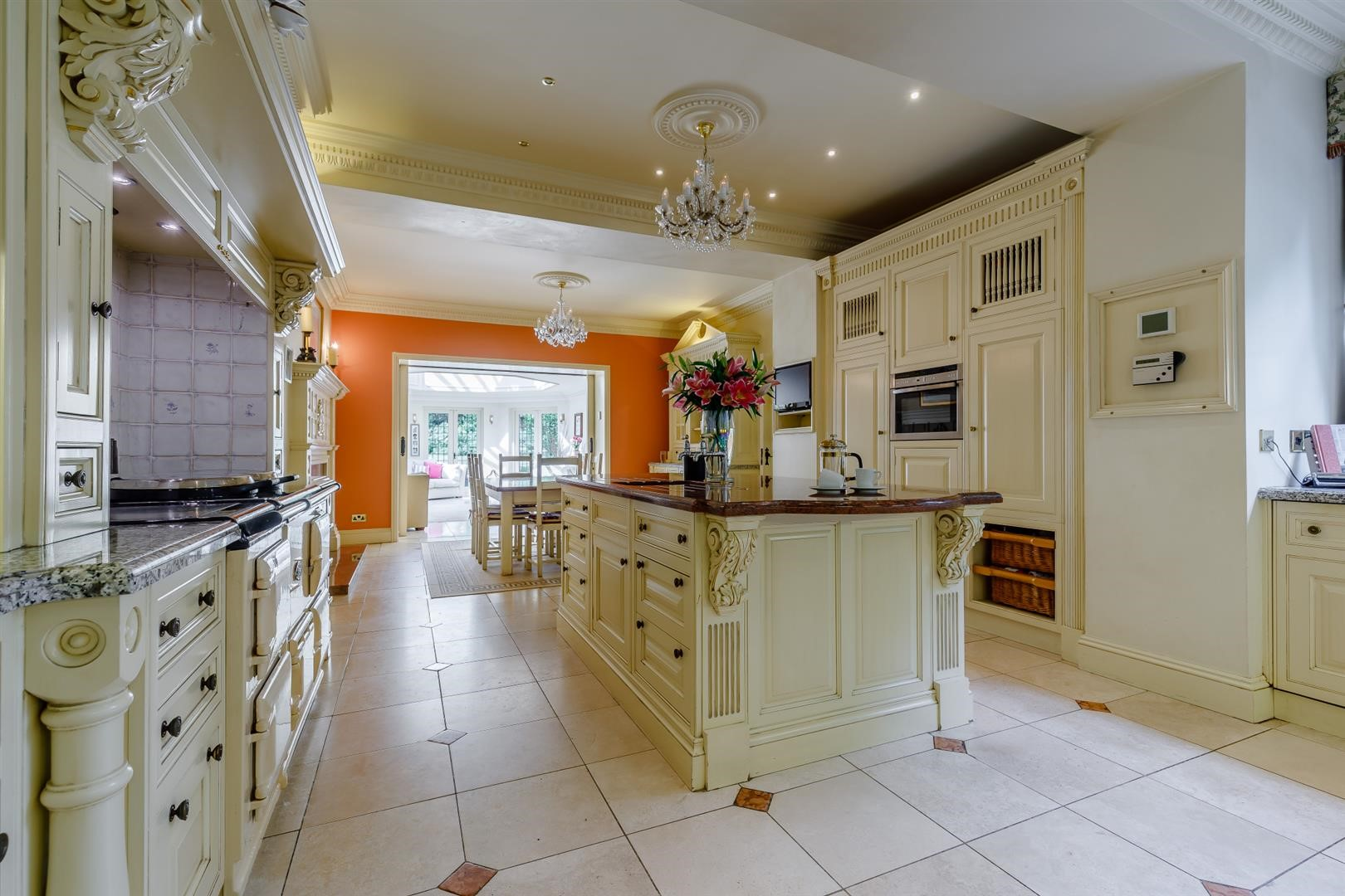 luxury bespoke Clive Christian designer kitchen and chandelier in Victorian house
