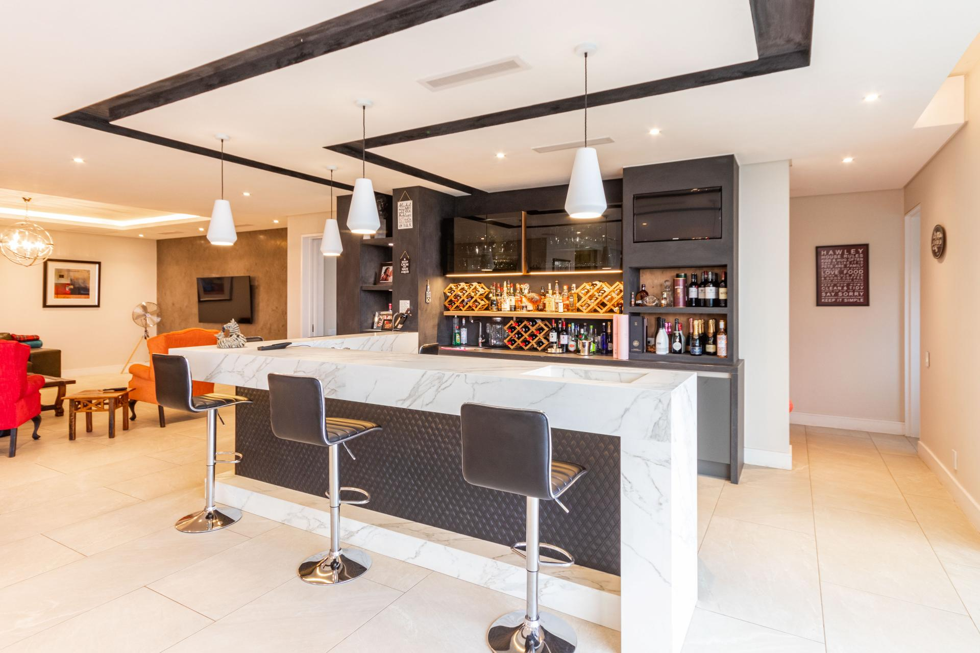 luxury marble and leather home bar area in party house