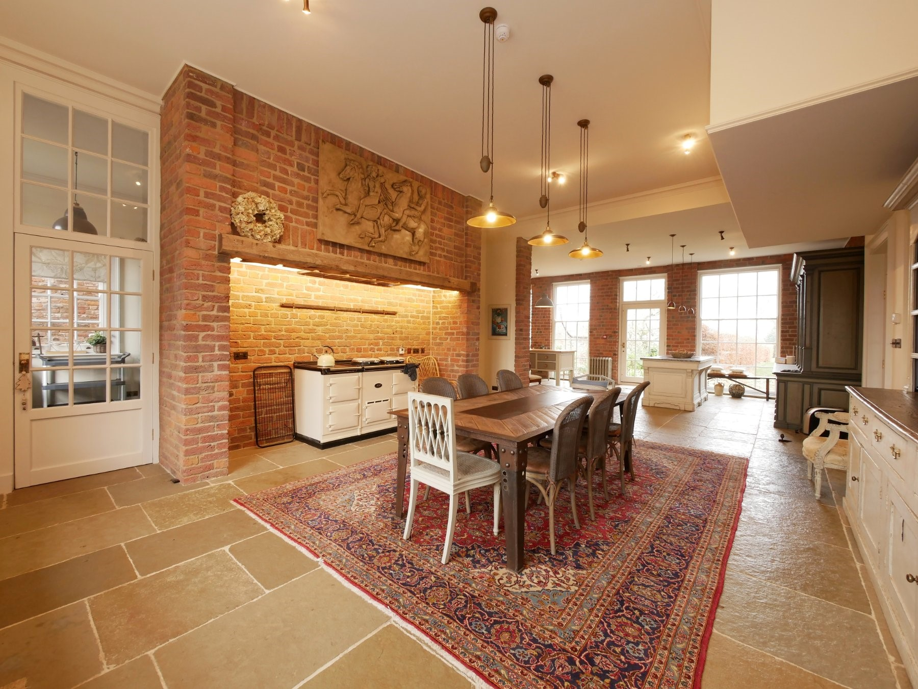 manor house traditional kitchen stone flooring aga dining table persian rug