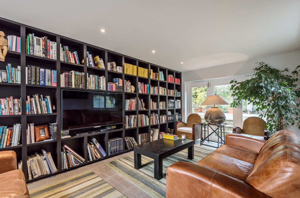 modern contemporary library book shelf tv room