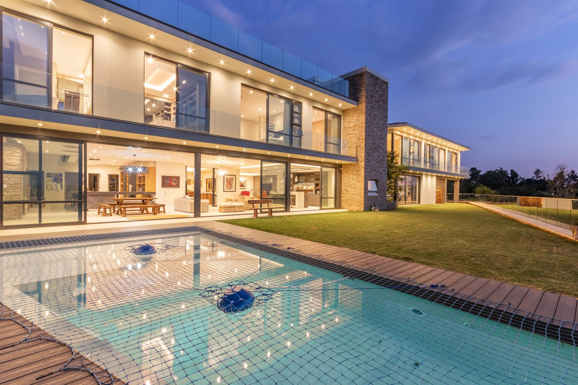 modern contemporary mansion in South Africa with swimming pool and glass doors