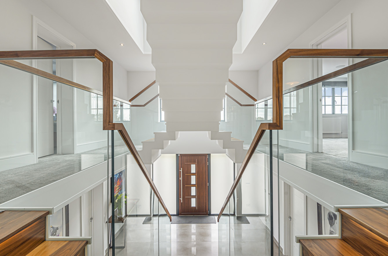 modern double height valuted reception hall with floating staircase