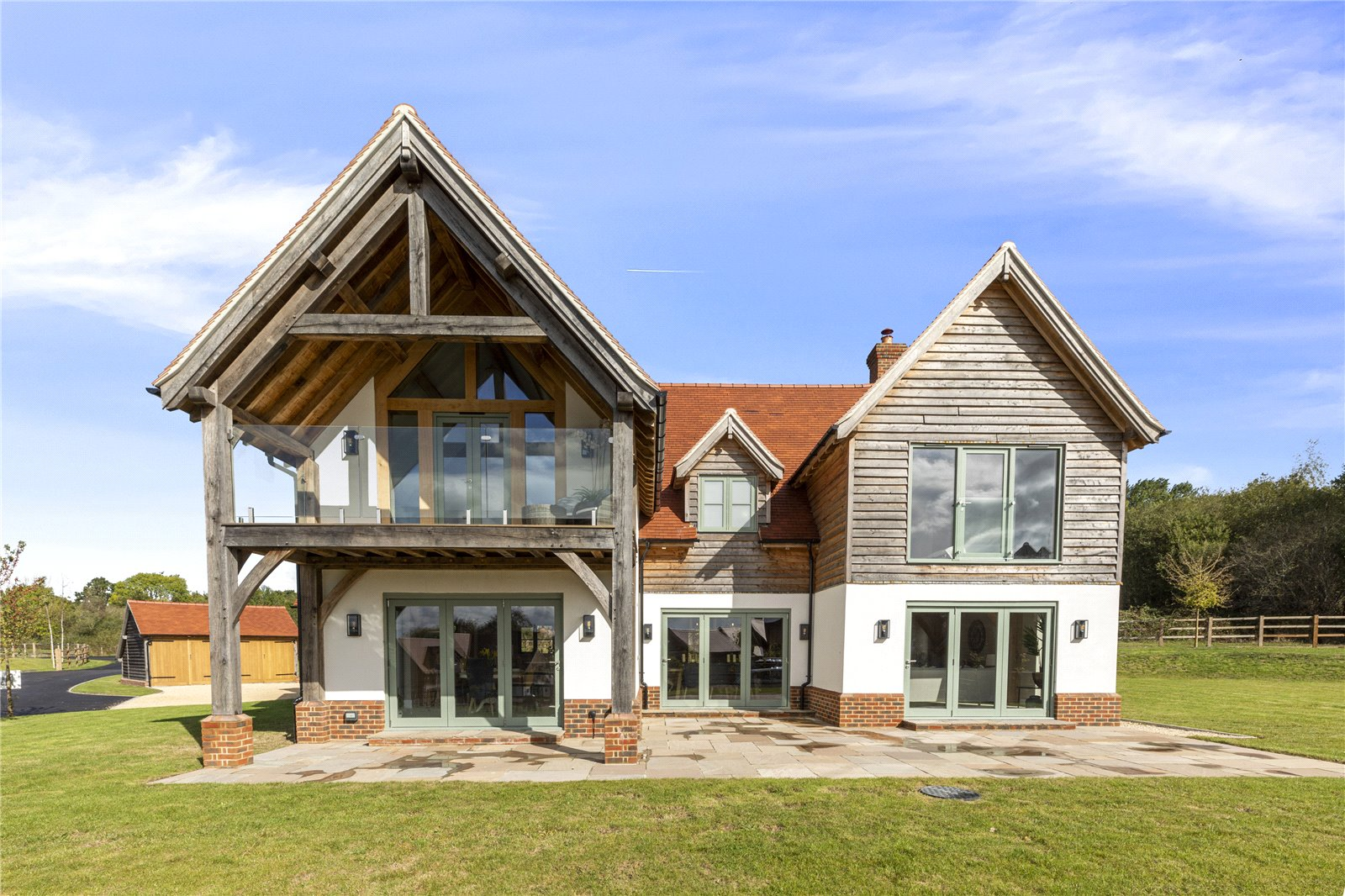 new build contemporary timber cladded nordic lodge inspired house