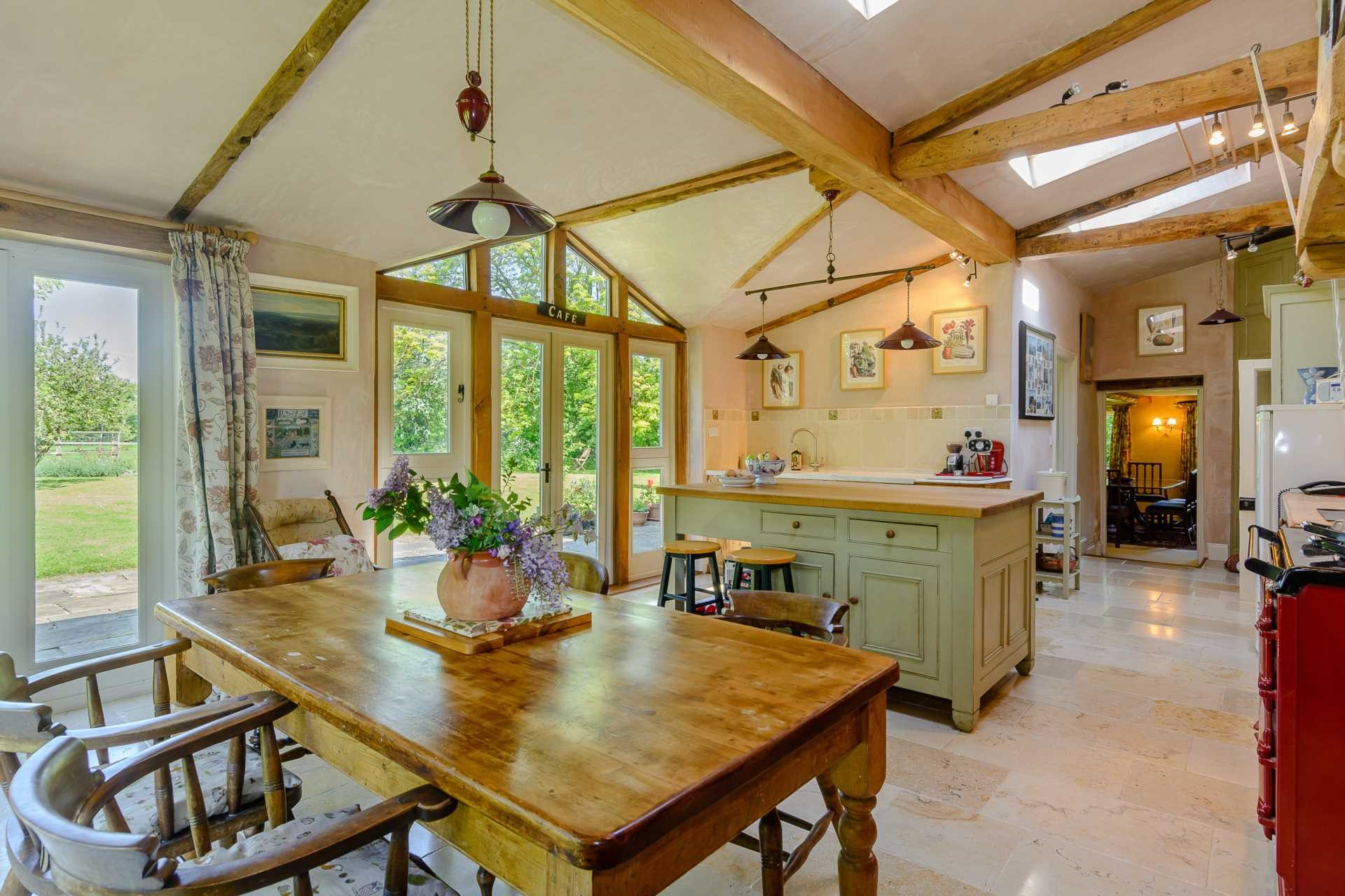 open plan kitchen breakfast family room traditional interiors exposed beams farmhouse