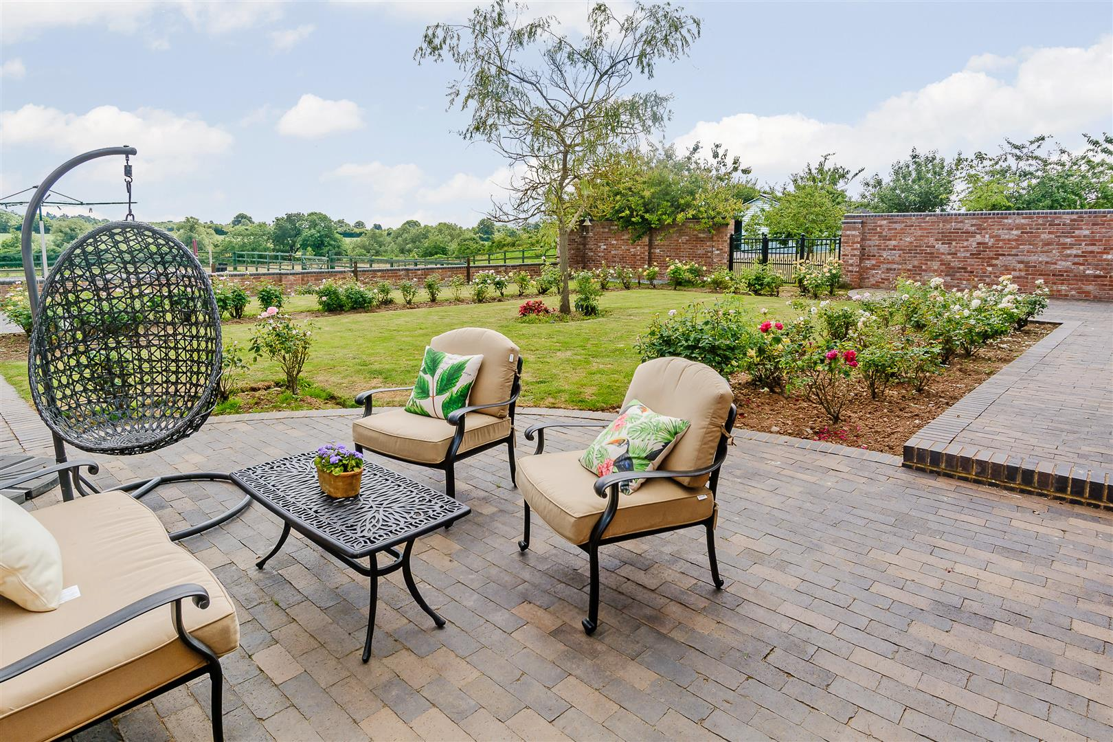 outdoor entertaining terrace with landscaped gardens