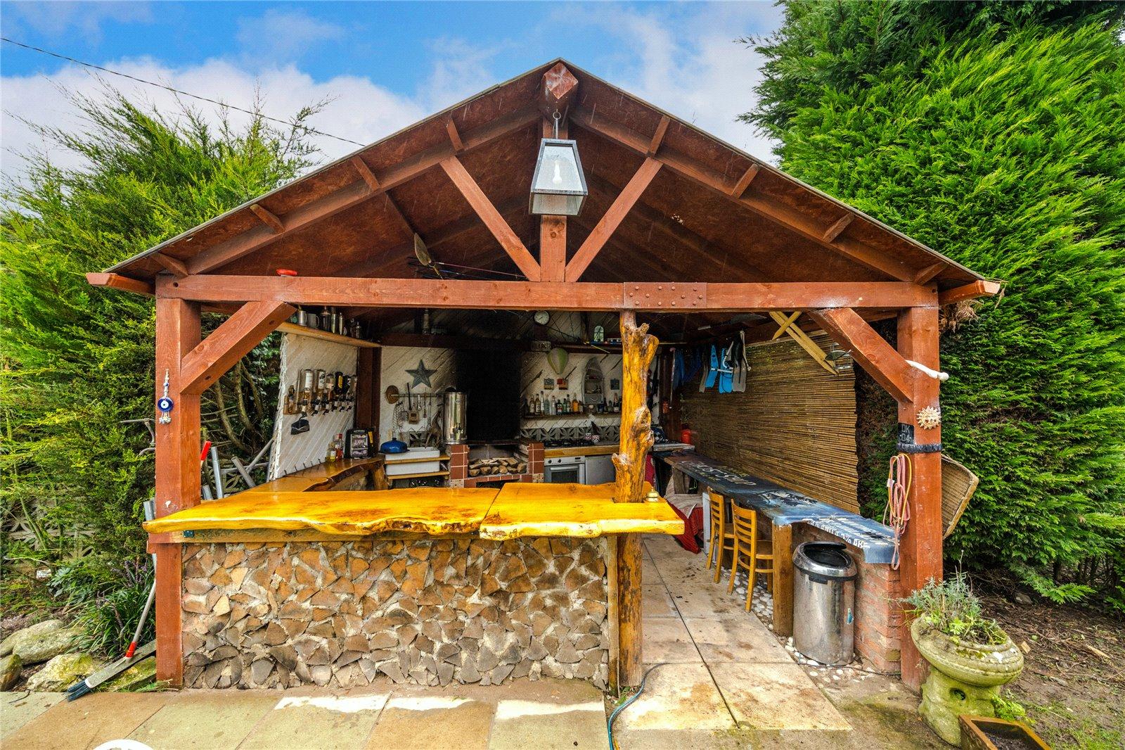 outdoor tilkki style wooden bar and kitchen