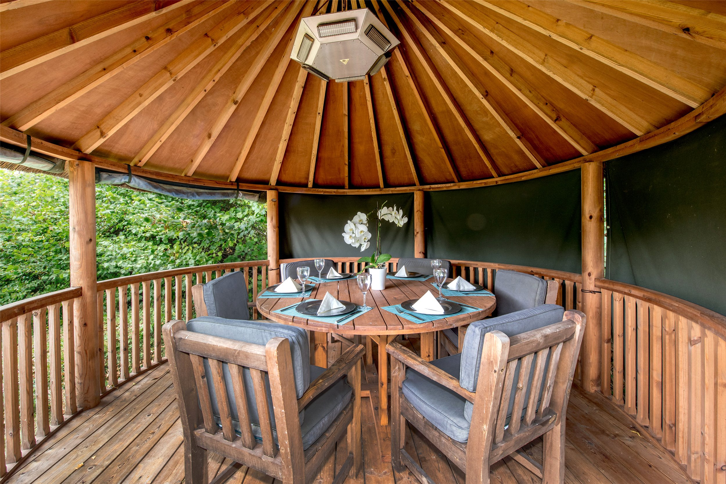 outside dining in African Hut style deck area