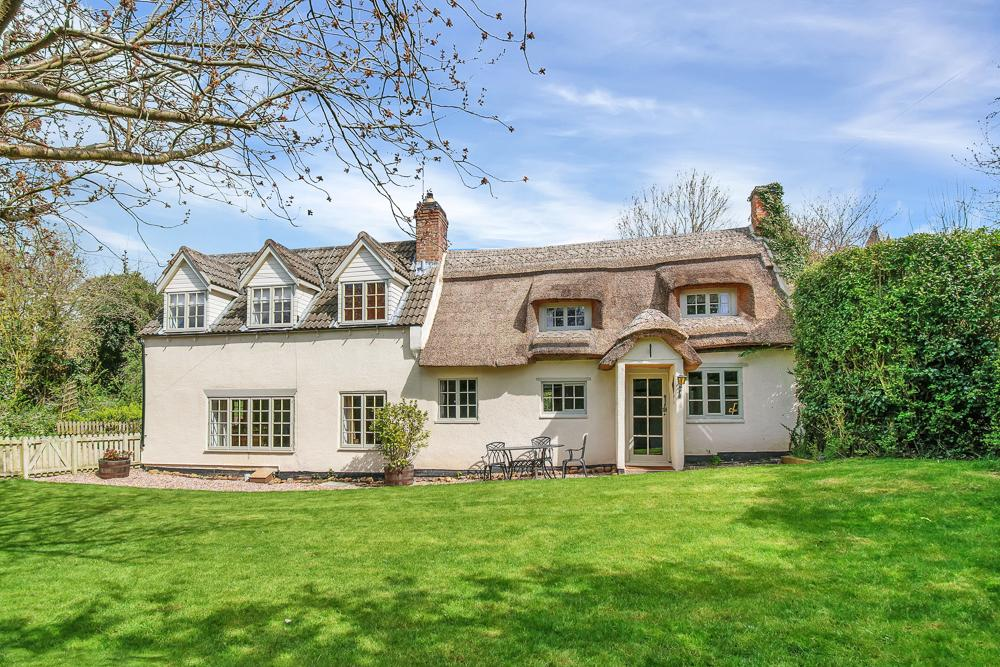 part thatched modernised character cottage in countryside