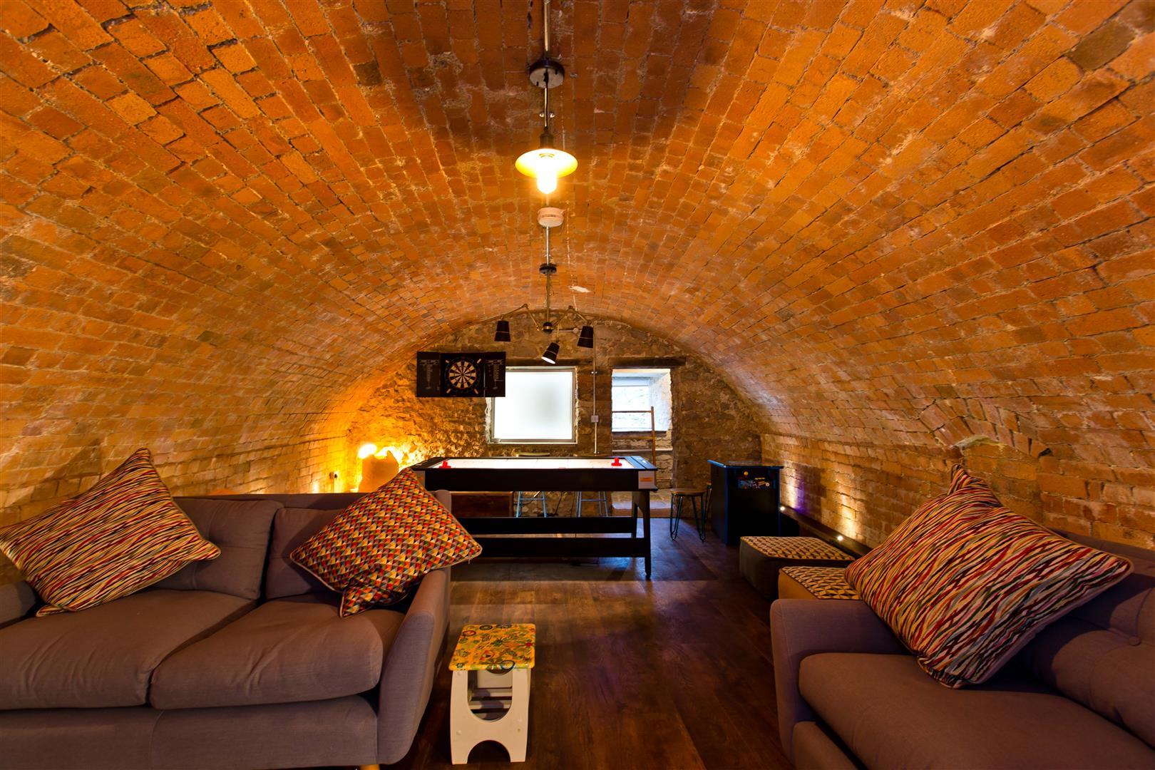 round ceiling converted barn bar and games room