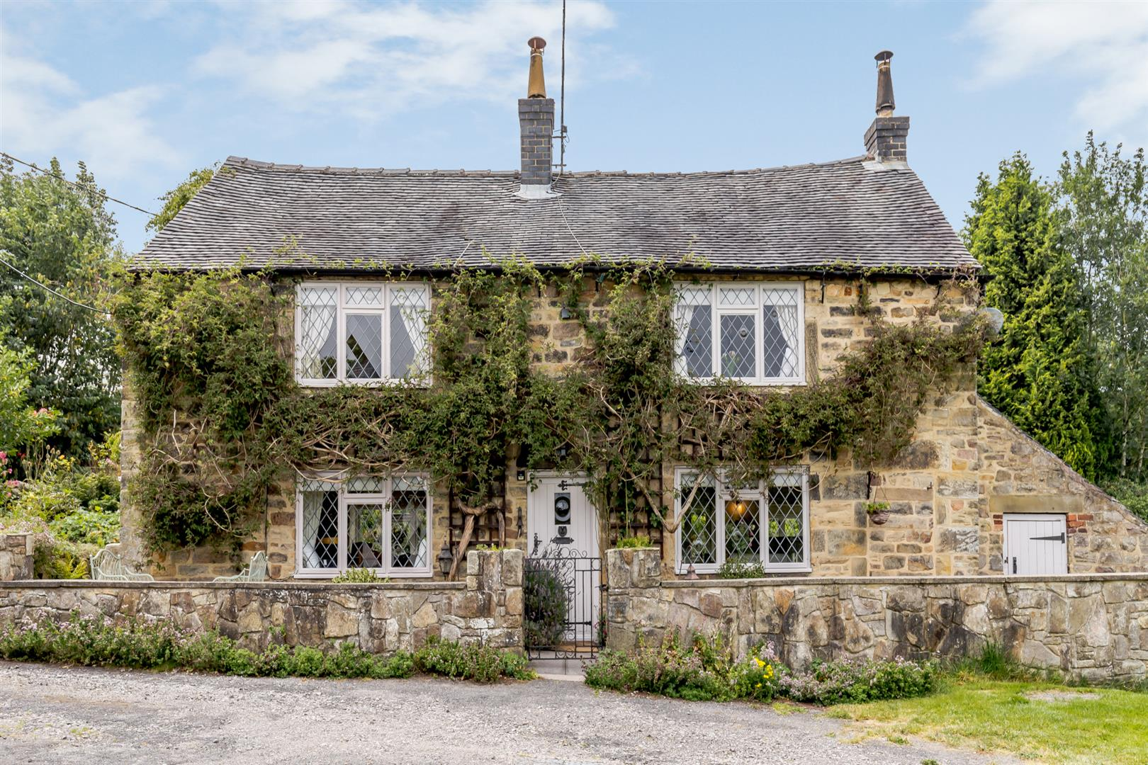 stone built chocolate box cottage in Derbyshire