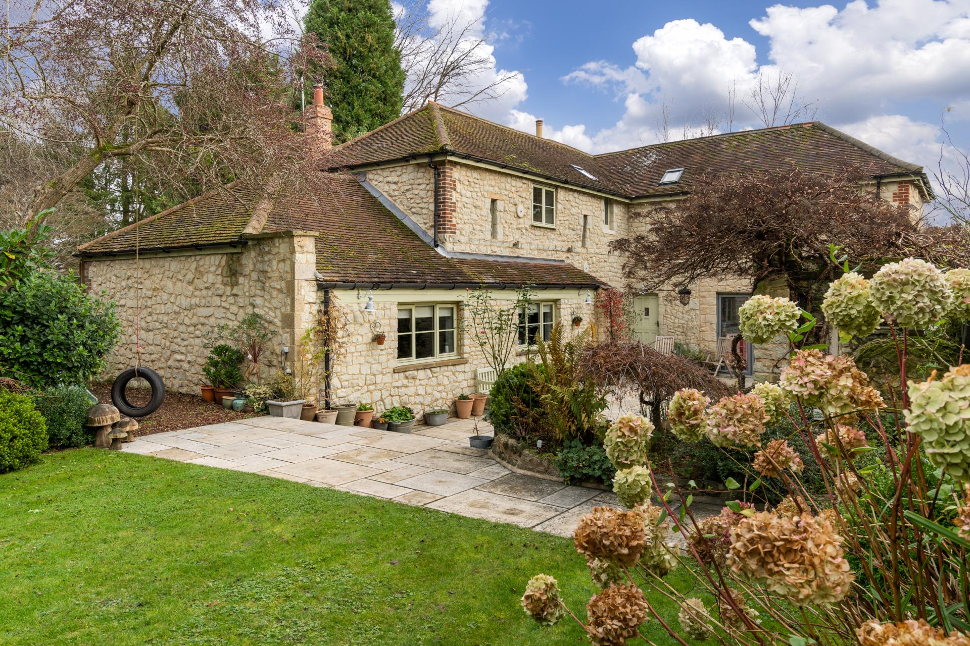 stone built English Victorian villa with olive painted doors and windows