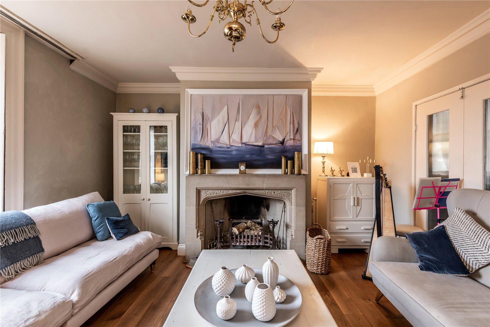 symmetrical neutral and blue Georgian home interior with Tudor fireplace