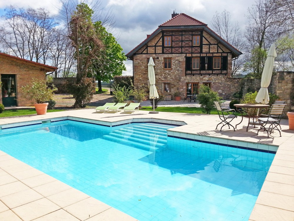 Traditional German holiday villa with Turkish swimming pool terrace area