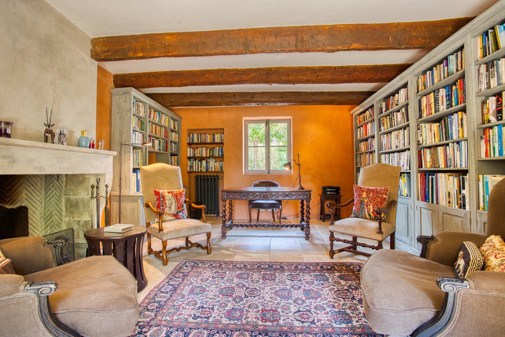 traditional medieval library office with grand fireplace