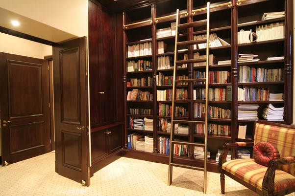 traditional personal library with sliding ladder chestnut wood