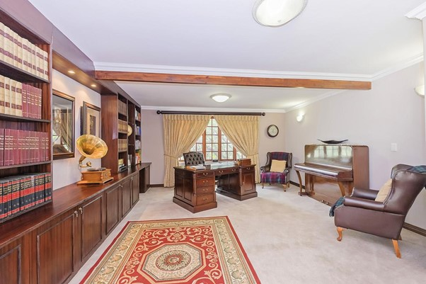 traditional South African office reading room interior dark wooden cabinets
