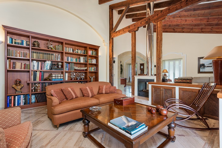 traditional Spanish sitting reading room with bookcase