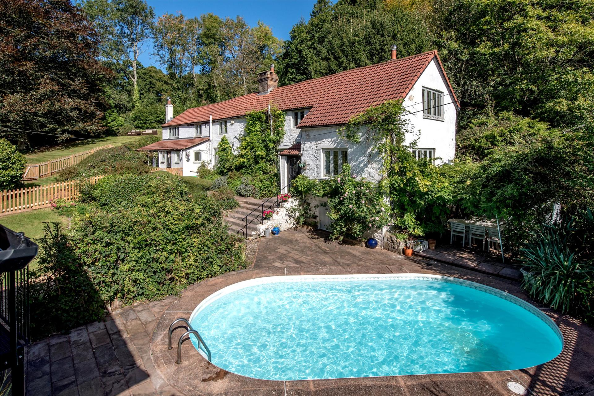 white country house with outdoor swimming pool
