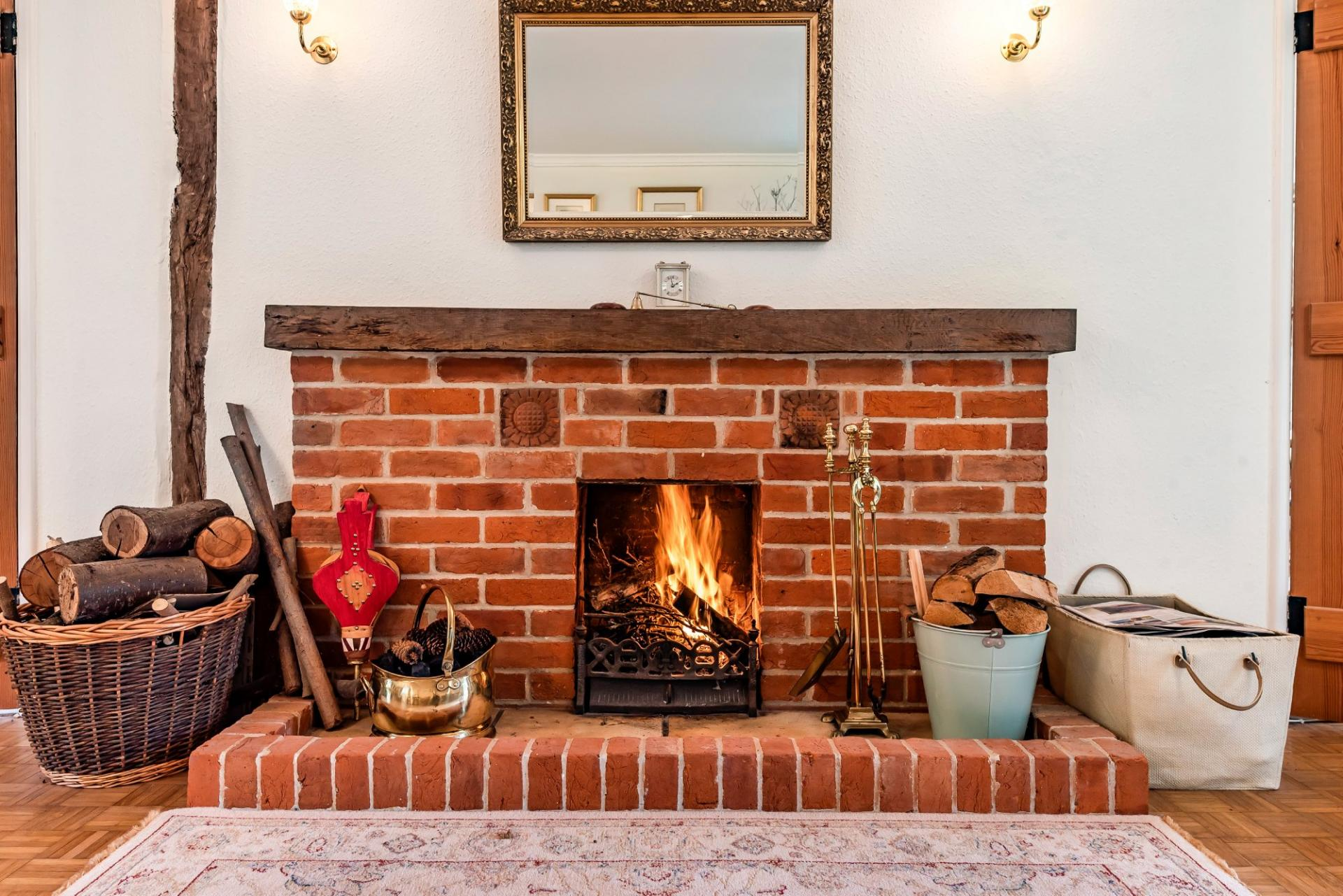 wintery exposed brick fireplace with roaring lit fire