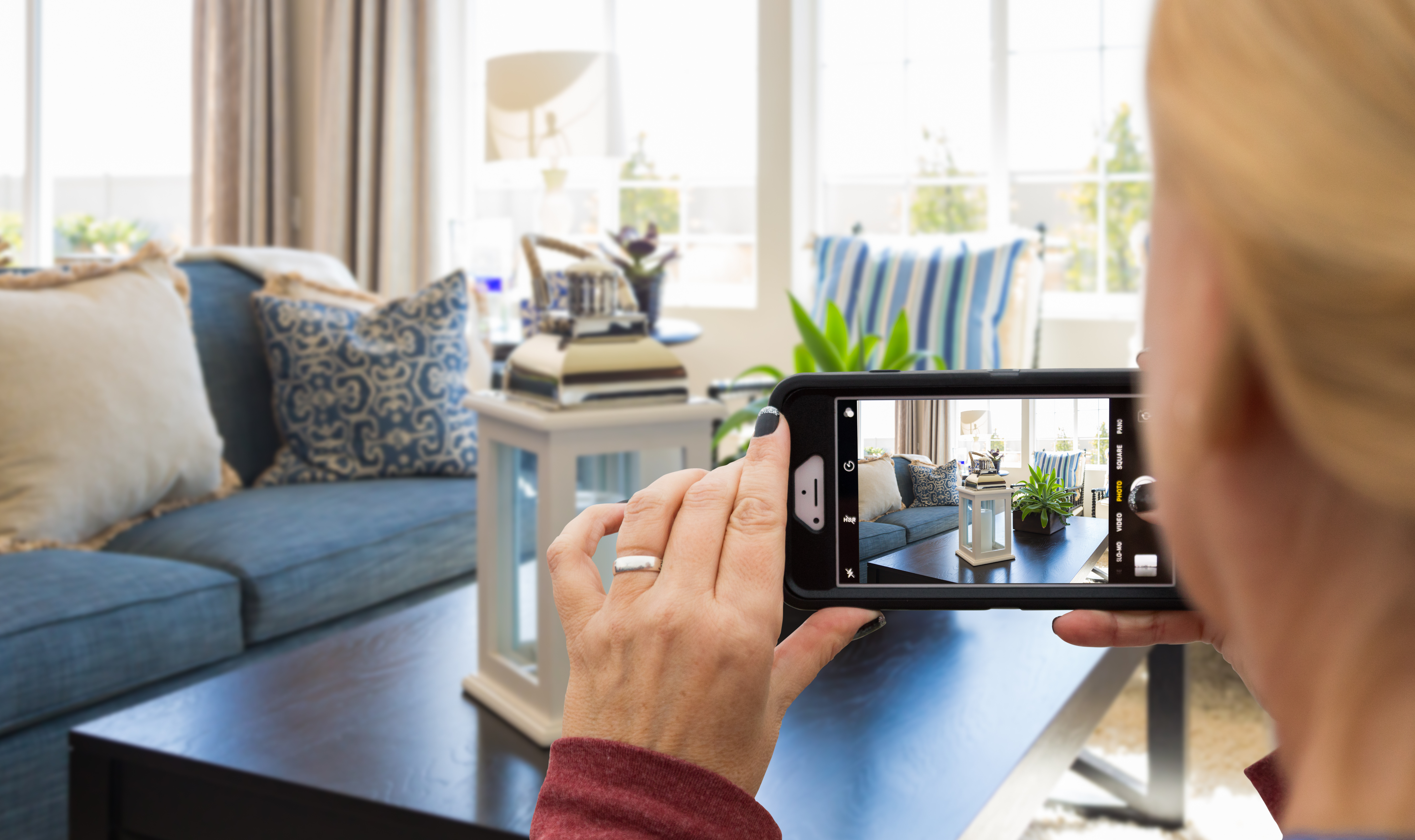 Woman Taking Pictures of A Living Room in Home with Her Smart Phone