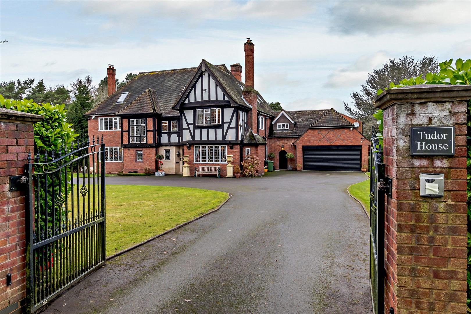 Worcestershire tudor period country home with iron gated drive