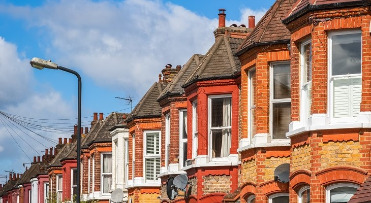 a_row_of_red_brick_british_terraced_houses_in_london