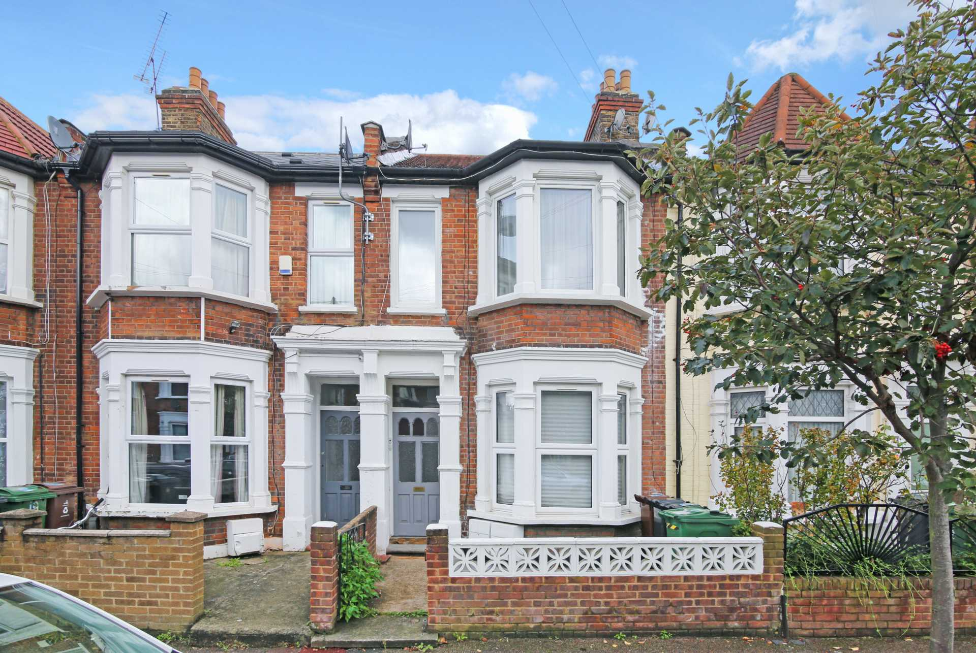 beautiful London flat in terraced house with white frame bay windows