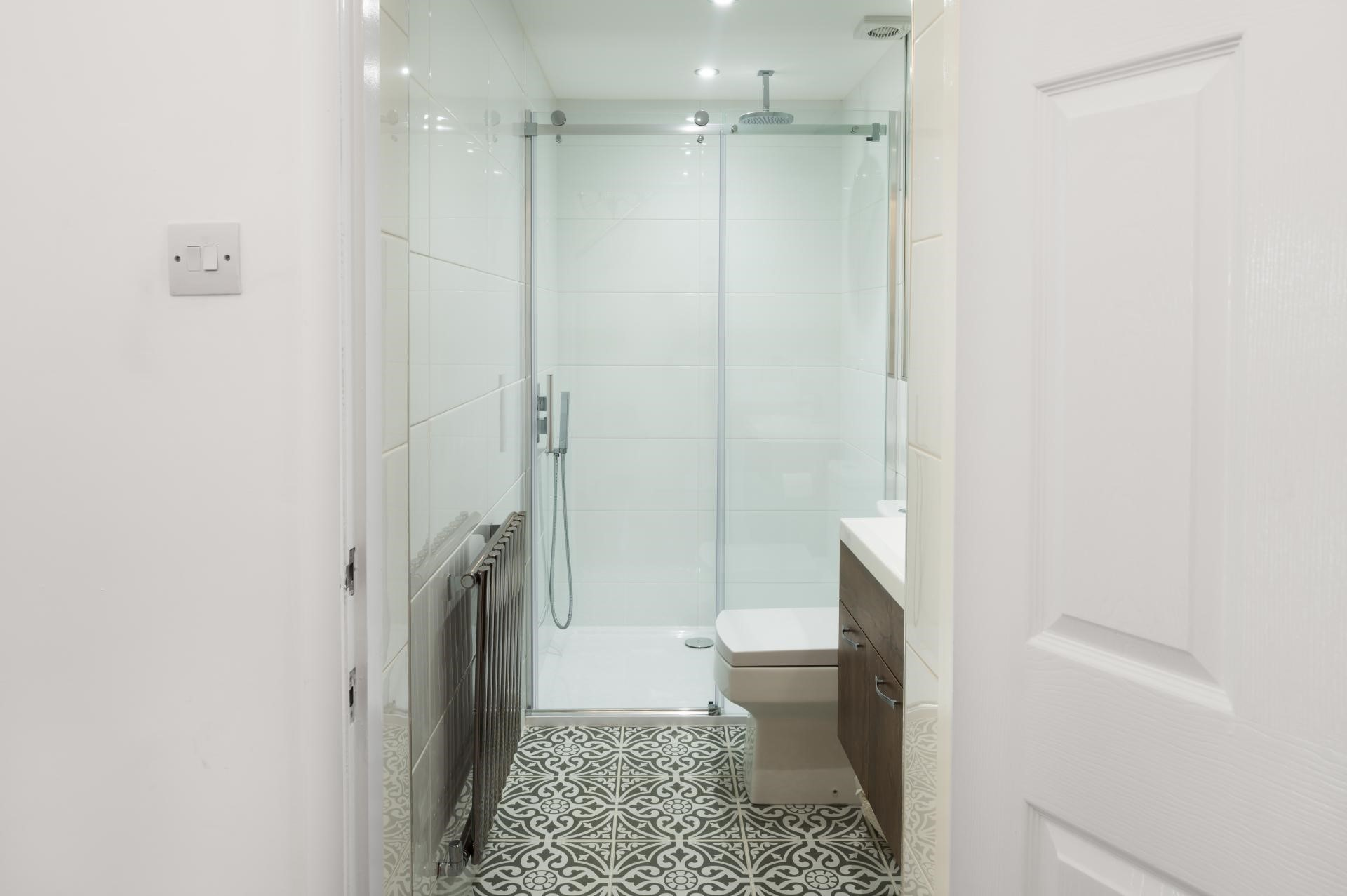 black and white patterned tiles in small bathroom